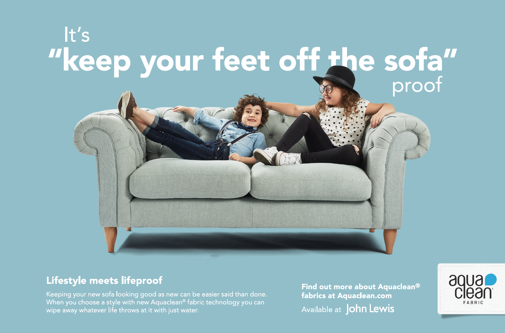 Print advert with boy and girl playing on a sofa